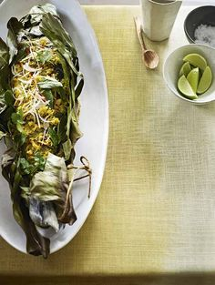 Indonesian baked sea bass: spectacular doesn't have to mean complicated and a whole fresh fish, slathered with a fragrant coconut and lime paste, wrapped in palm leaves and baked, is incredibly impressive – no need to let on how easy it is to cook. Recipes Alice Hart, styling Emma Thomas, photographs Emma Lee. http://www.hglivingbeautifully.com/2015/06/07/zest-for-life-3-recipes-celebrating-citrus-fruit/