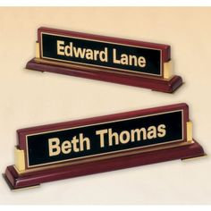 "Our Executive Rosewood Desktop Nameplate features a rosewood stained piano finish nameplate with gold brackets and a black/gold engraving plate. Item 588 measures 2.75"" x 10.5"" in size."