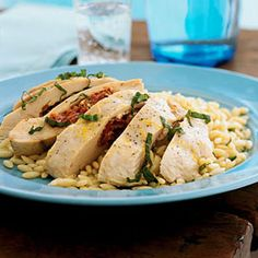 Feta, Herb, and Sun Dried Tomato Stuffed Chicken....seeing as I tend to eat chicken at every dinner, i figured i would try and mix it up a bit each time. This is just one of the many delicious (and healthy) chicken recipes at www.cookinglight.....