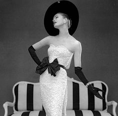 Susan Abraham in John Cavanagh's strapless evening gown, photo John French,London, UK, Spring 1957.
