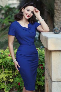 Feel like a real woman when wearing this classy 50s Megan Pencil Dress, just like Idda van Munster, and... is also exclusively available at TopVintage!Sexy yet sophisticated... Super feminine cut and an elegant fold over collar with playful tie straps. The belt ensures a beautifully defined silhouette, oh la la! Made from a light stretchy, royal blue cotton blend which hugs your curves perfectly. Give a girl the right dress, and she can conquer the world ;-)    Round neckline Fixed...