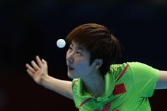 Ning Ding eyes her next shot. An Olympic photograph by Feng Li