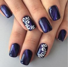 Gorgeous dark blue nails with white nail art