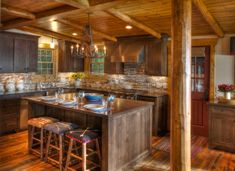 cabin designs and floor plans pillar stools island wood floor flowers wall cabinets chandelier windows stove countertop rustic kitchen of Interesting Ideas for Cabin Designs and Floor Plans and Cabins to Observe to Get Them