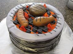 Labor Day Cookout Grill Cake Labor Day Cookout Grill Cake Everything is edible , the burger , hotdog, & chicken are made with mm fondant the grill marks are
