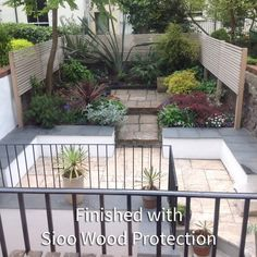 Western Red Cedar Slatted Fence finished in Sioo
