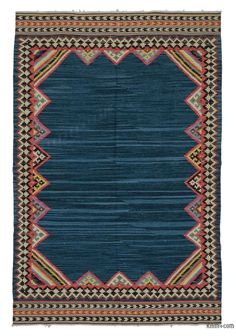 Beautifully transform your living space with our handmade, authentic and timeless new kilim rugs that carry with them many of the traditional elements that made true vintage Turkish Kilim rugs so precious. Each kilim is skillfully hand-woven in Turkey with  vegetable dyed and hand spun wool  to create a beautiful piece of art and make sure they age gracefully.This fine blue rug measures 5'8'' x 8'8'' (173 cm x 263 cm). We can customize it by adding your monogram or removing the fringes upon…