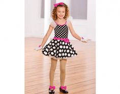 Ref: RV0341  Leotard of black and white small polka dot spandex has white organdy sleeves. Attached spandex circle skirt has top layer of larger polka dot pattern over layers of white organdy and attached waistband of fuchsia spandex with bow trim. Gloves have bows that match headband and shoe bows.