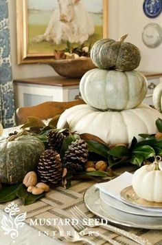 Stacked pumpkins. The white and green look is simply lovely!
