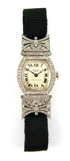 Art Deco diamond set lady's 'turtle' wristwatch by Cartier, Paris c.1920, the tortoise shaped silvered dial with black Roman numerals, rose diamond set bezel and winder, the shaped rectangular shoulders pierced and millegrain set with rose diamonds, mounted in platinum, the case back in gold, serial numbers 16476, 6956 and possibly 6932 (second digit overstamped)
