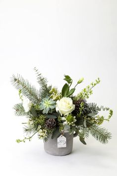 THE JOY OF CHRISTMAS. A wild 'just picked' design of succulents, roses, lakspur, cape lilies, wax flowers and Christmas greens. Christmas Planters, Christmas Greenery, Christmas Rose, Christmas Wreaths, Christmas Decorations, Banquet Decorations, Christmas Candles, Beautiful Christmas, Christmas Flowers