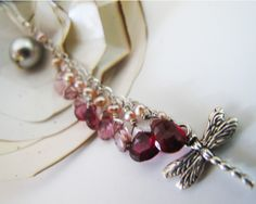 dragonfly earrings, rhodonite garnet, pink tourmaline and pink freshwater pearls paired with sterling silver dragonflies, adove fine jewelry