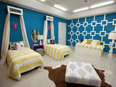 LOVE the white on teal focal wall!   Mikel and Britany - Design Star House Bedroom