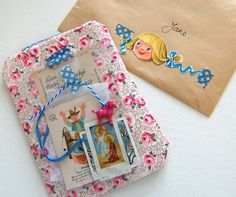 cool wrapping - could use bit out of that vintage book I cut up to make my heart garland!