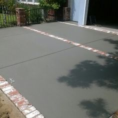 Concrete driveway with brick ribbons
