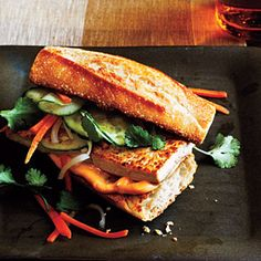 The bread and Vietnamese filling—carrot and radish, cilantro, mayonnaise, and cucumber—are traditional in this vegetarian take on this classic Vietnamese sandwich. Prepare mayonnaise mixture and toast bread while the tofu and vegetable mixture marinate. Tofu Recipes, Vegetarian Recipes, Cooking Recipes, Healthy Recipes, Vegetarian Bahn Mi, Vegetarian Cookbook, Going Vegetarian, Vegetarian Breakfast, Vegetarian Dinners