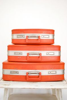 Awesome orange vintage suitcases. Please?