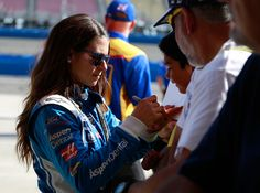 Danica Patrick Photos Photos - Danica Patrick, driver of the #10 Aspen Dental Ford, signs autographs during qualifying for the Monster Energy NASCAR Cup Series Auto Club 400 at Auto Club Speedway on March 24, 2017 in Fontana, California. - Auto Club Speedway - Day 1