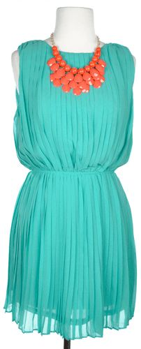 Gorgeous green pleated dress with a deep v in the back.