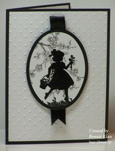 handmade card from Stamping with Klass: Sweet Silhouette ... black and white ...like the layout with silhouette in matted oval ... ribbon detail looks like a hanger for the oval ... classic black and white ...