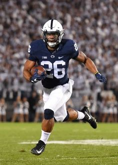 Penn State running back Saquon Barkley (28) is tackled by