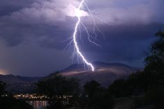 Zap! How's that for timing? This bolt actually sparked a brush fire in Wenatchee last night. Check it out: http://nwcn.tv/OnD0VW  Photo: Michael Bendtsen / McGlinn's Public House