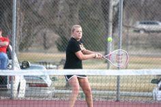 Senior Kendall Meier returns a serve