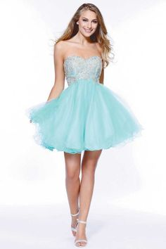 Sweetheart Homecoming Dress NX6212. Short Sweetheart and Strapless Homecoming Prom Dress with Sparkling Beading Embellished Bodice, Empire Waist and Open Back with Lace-up Closure, Tulle Layered Flowing A-Line Skirt with Ruffle Hem. https://www.smcfashion.com/wholesale-homecoming-dresses/sweetheart-homecoming-dress-nx6212