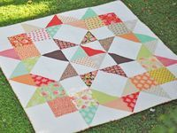 Big cute quilt.  Tutorial here:  http://www.unitednotions.com/Moda-Love-Layer-Cake-Quilt.pdf