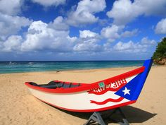 Lovely Beach With Painted Puerto Rican Flag On Boat Rico