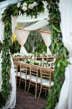 Oh my! Stunning combination of foliage and fabrics. #gardenwedding #greenandwhitewedding
