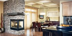 3 sided fireplace in a cozy dinette