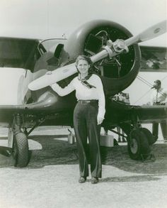 """""""Jackie Cochran with the Staggerwing Beechcraft she flew in the 1937 Bendix Trophy Race. Finishing third, Cochran set a women's speed record of 203.9mph and established an altitude record of more than 30,000 feet. She would win overall first-place the next"""" (via)"""