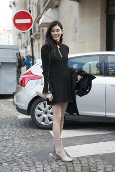 Ming Xi wearing a J.W. Anderson dress, Givenchy bag, and Acne shoes - Fall 2016 Paris Fashion Week Day 3 - March 3, 2016