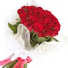 Bouquet of red roses with white color transparent packing.