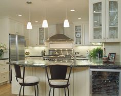 Lighting over k. Island.  contemporary kitchen by Dzignit, Patrice Greene