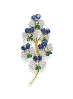 SUPERB JEWELS FROM THE COLLECTION OF H.S.H GABRIELA PRINCESS ZU LEININGEN: A MULTI-GEM FLOWER BROOCH, BY JEAN SCHLUMBERGER, TIFFANY & CO. Designed as a spray of flowers, each pavé-set with diamonds, to the yellow diamond, pear-shaped sapphire and emerald details, with a polished gold stem.