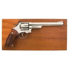 Smith & Wesson Model 29 Nickle 8 3/8 in barrel.  Sweet!  She owns it now!