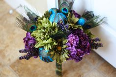 Peacock Wedding Bouquet - Peacock Feathers Plum, Green, Teal Bridal Bouquet - Made to Order. $110.00, via Etsy.