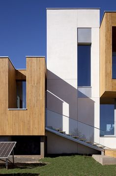 Contemporary Duplex House Designed in Passive House Concept: Modern Minimalist Exterior Design With Plenty Of Wooden Accents For Wall Siding...