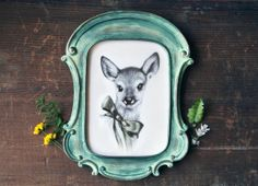 Nice Etsy find: Handmade prints of woodland animal illustrations. (Isn't the frame great?)