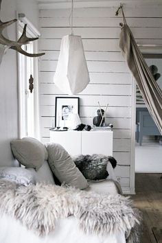 Neutral and white cozy nook. Um YES.