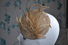 This pillbox is made from metallic gold coloured sinamay. The tips of the petals have gold and silver rhinestones on them to give a subtle sparkly effect. It is very lightweight and comes attached to hat elastic which is a easy and comfortable way to wear hats. The diameter of the item is just over 5 inches (12.5cm).  Can be made in other colours upon request.  ***********