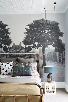 An easy way to upgrade a boring bedroom is to add in some beautiful wallpaper like this gorgeous urban landscape. You could just do one wall for a great statement!