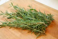 How to freeze fresh rosemary: cut branches off of rosemary bush, wash, dry, and freeze in a ziploc baggie. After a few weeks, leaves should fall off the stems when removed from the freezer.