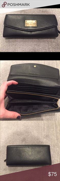 Michael Kors Wallet Michael Kors Black Leather Wallet. Inside Zip pocket and outside pocket. Michael Kors Bags Wallets