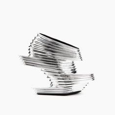 Nova Shoe Silver Chroming Vinyl + Carbon Fiber | Zaha Hadid and United nude.  Drool.
