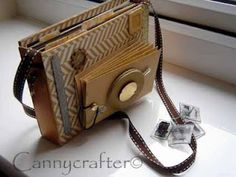 How cute! For any photo buff, this is an mini album created to look like a camera!