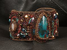 Unearthed A Bead Embroidered Cuff By:  Nancy Dale of NEDbeads  SOMEday I will make a cuff bracelet in this style -- everything is waiting for me in a drawer!  Angie