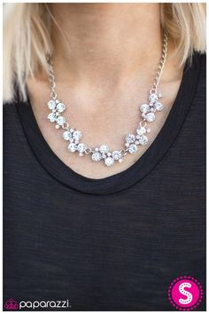 A row of dazzling white rhinestones drapes along the neckline, creating a sparkling display. Daintier white rhinestones are sprinkled along the clusters, adding luminous detail to the timeless design.